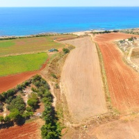 Golden Investment opportunity - Touristic Land for sale right on the beach 13000 square meters with title deeds!