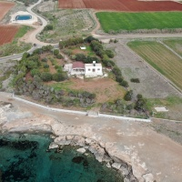 INVESTMENT OPPORTUNITY 5000m2 beachfront land for sale Ormidhia-Dhekelia with a small bungalow.